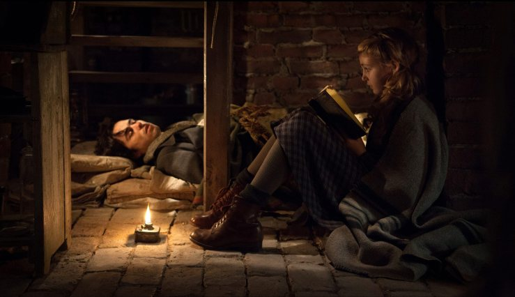 Liesel reads to Max in the cellar