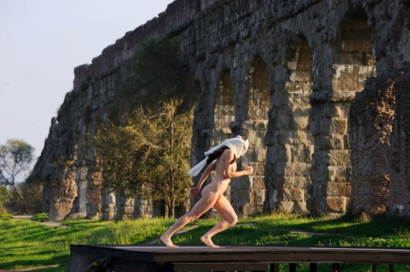 The naked poet runs into the aqueduct column