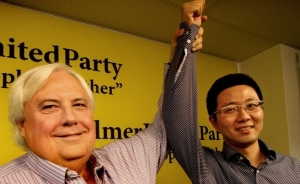 Senator Dio Wang gets a voting lesson from PUP owner Clive Palmer.