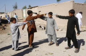 A group of children engaged in innocent gunplay