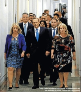 Front row forward Tony Abbott, supported by two stalwart (female) props marches towards the showdown