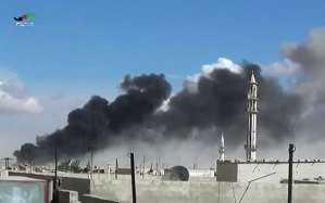 Smoke rises after airstrikes by military jets in Talbiseh, Homs province, western Syria,